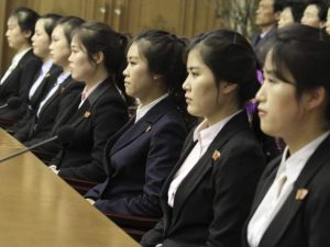 Colleagues of 12 North Korean waitresses are presented to the media (AP)