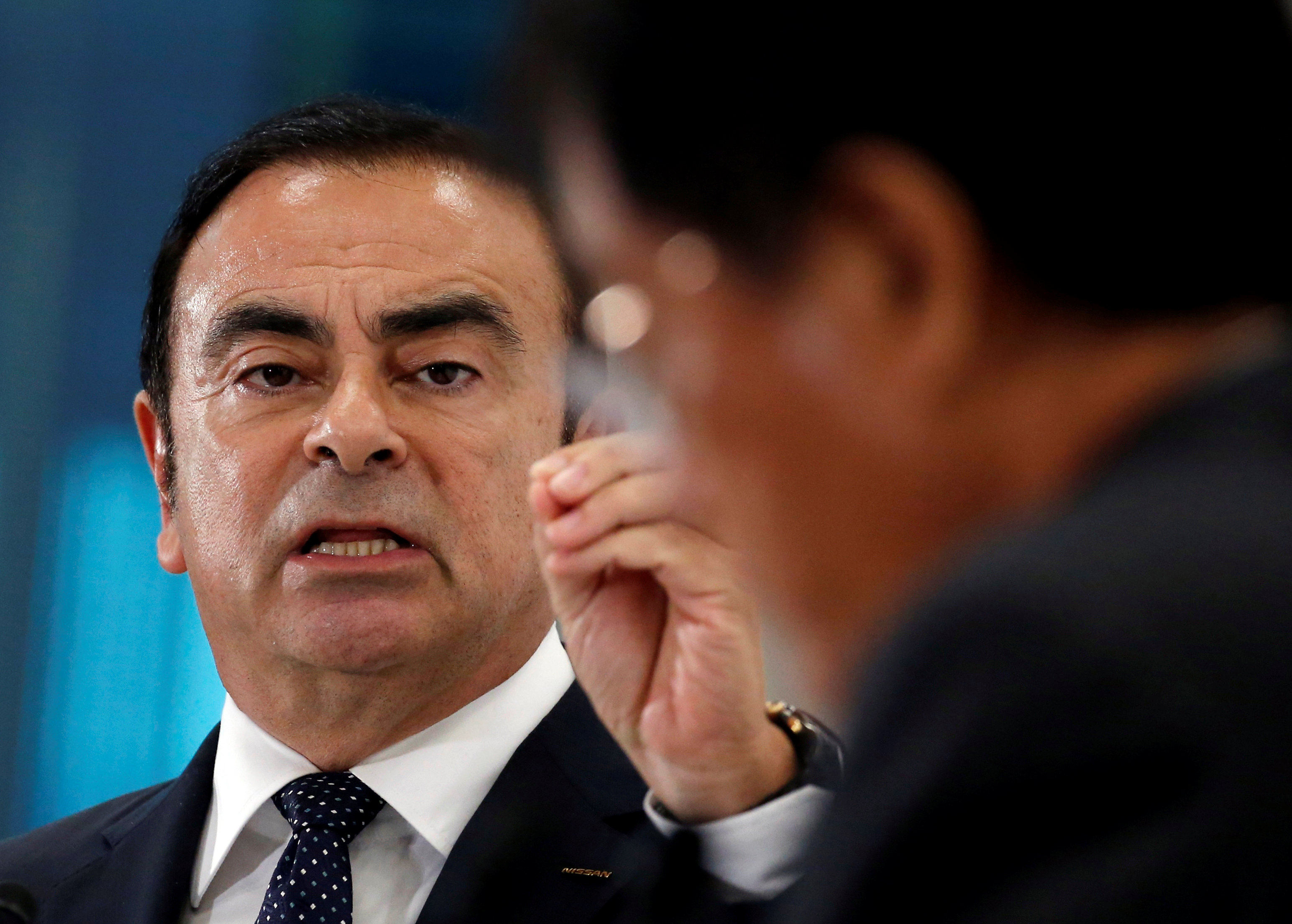 Ghosn, Chairman and CEO of the Renault-Nissan Alliance and Mitsubishi Motors Corp's Chairman and CEO Masuko attend their joint news conference in Tokyo