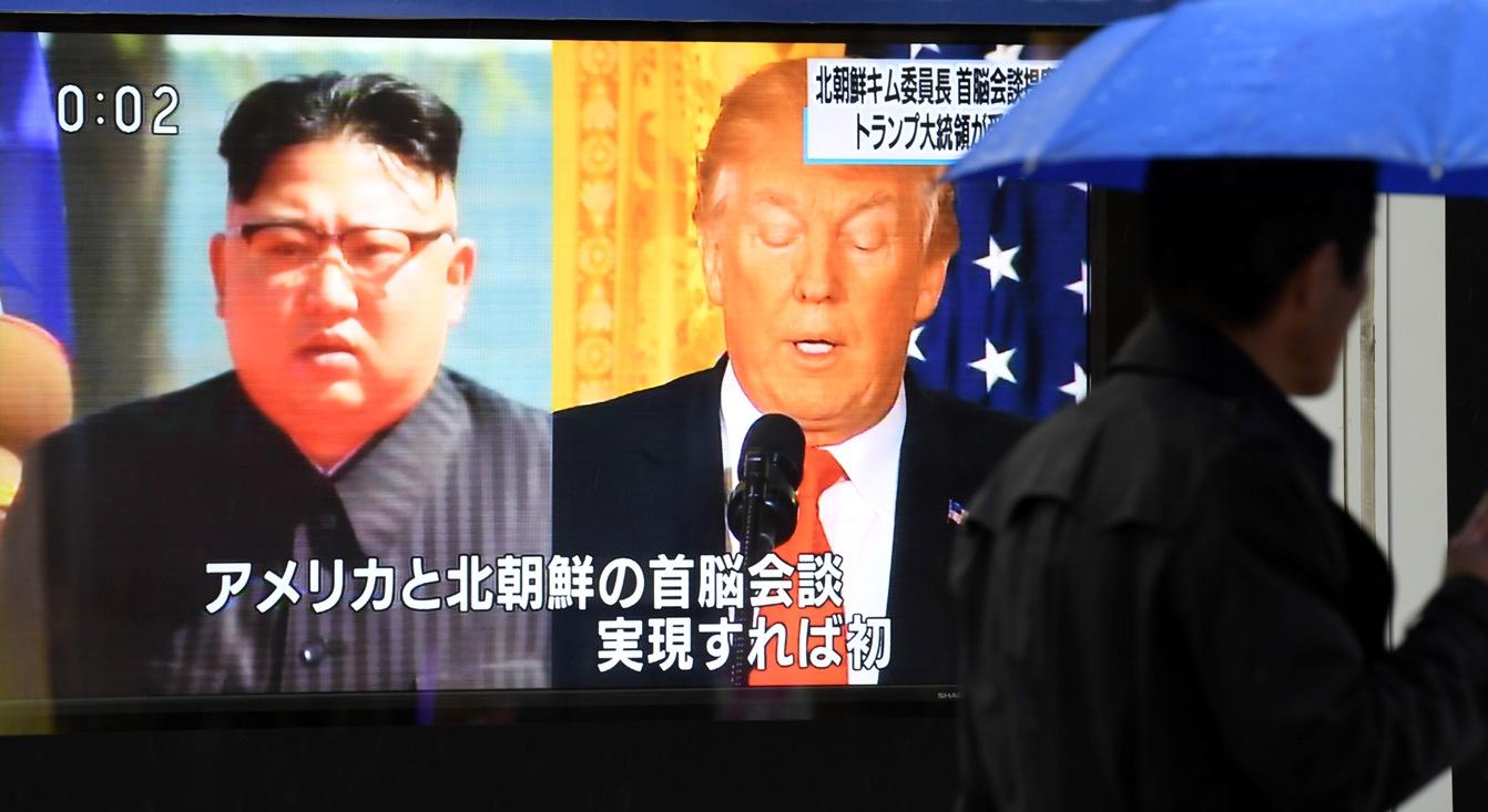 Kim Jong Un and Donald Trump on a television screen