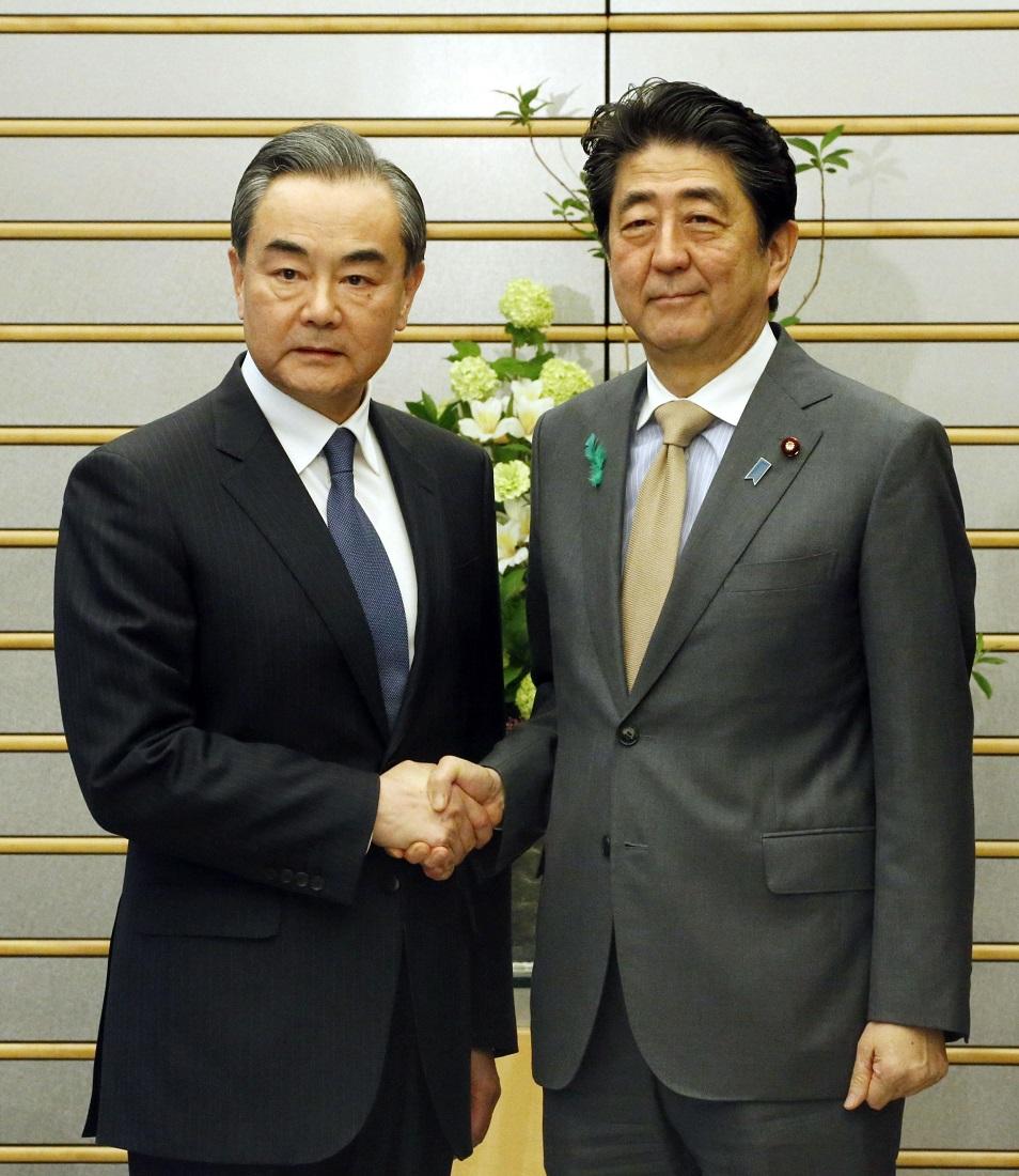 PM Abe and China's FM Wang Yi