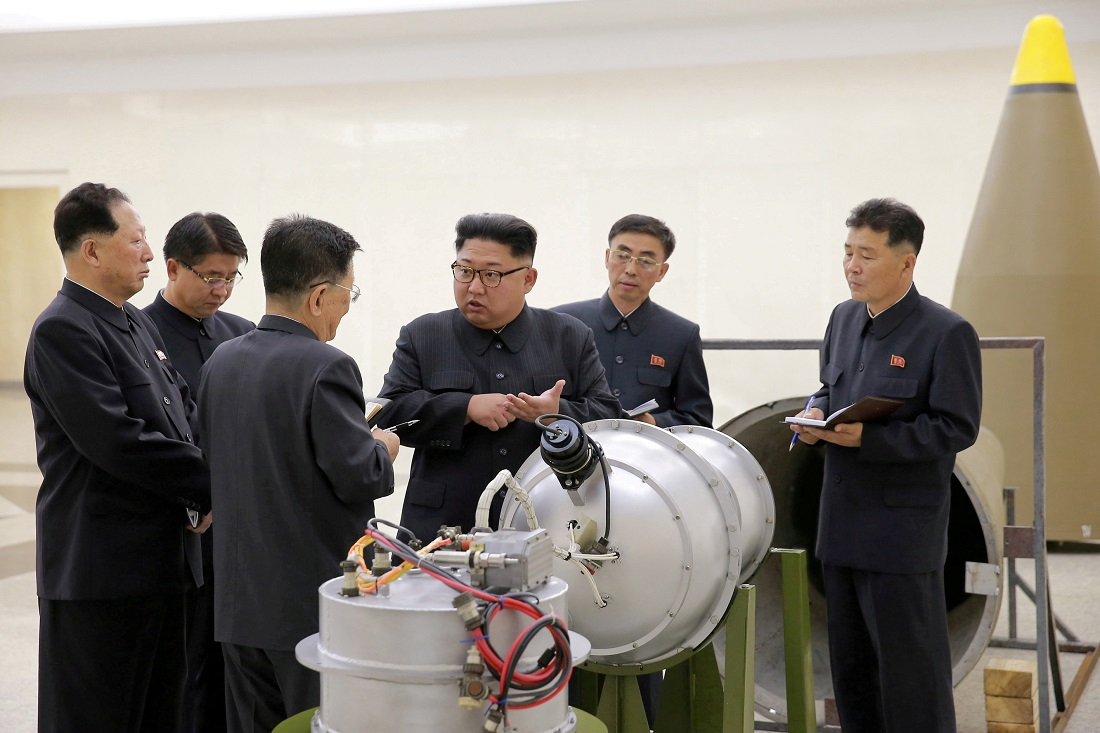 North Korean leader Kim Jong-un with the nuclear scientists