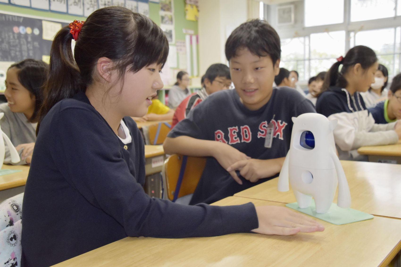 Japanese School Kids Learn English from AI Robots