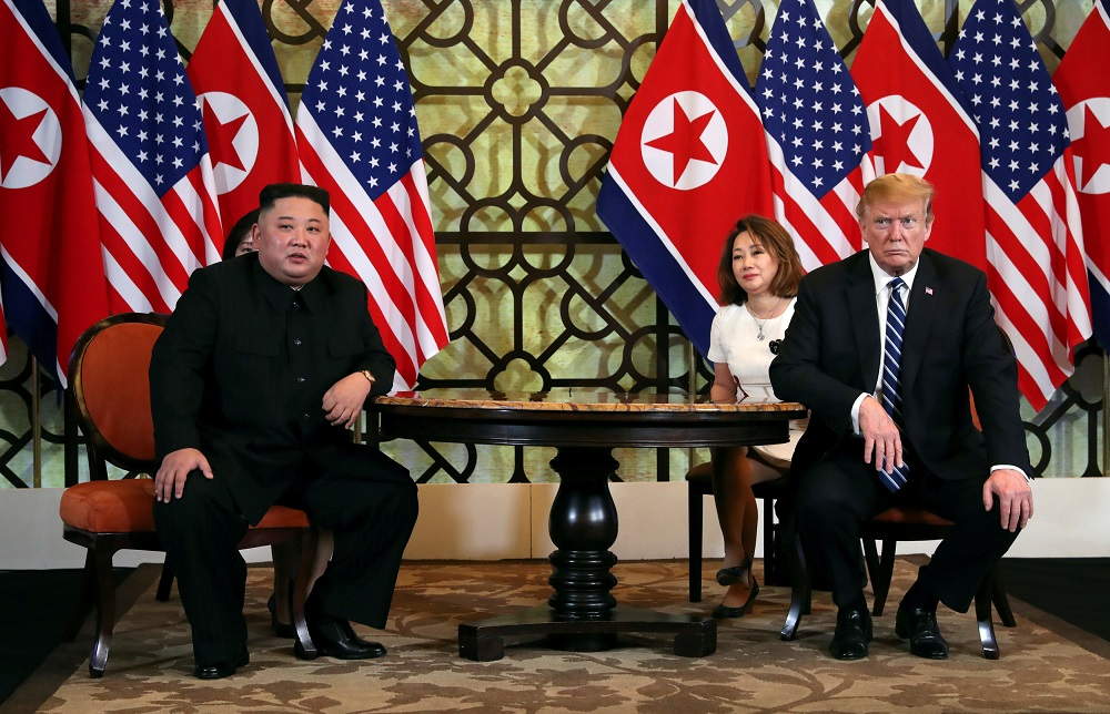 North Korean leader Kim Jong Un and U.S. President Donald Trump listen to questions from the media during the one-on-one bilateral meeting at the second North Korea-U.S. summit in the Metropole hotel in Hanoi