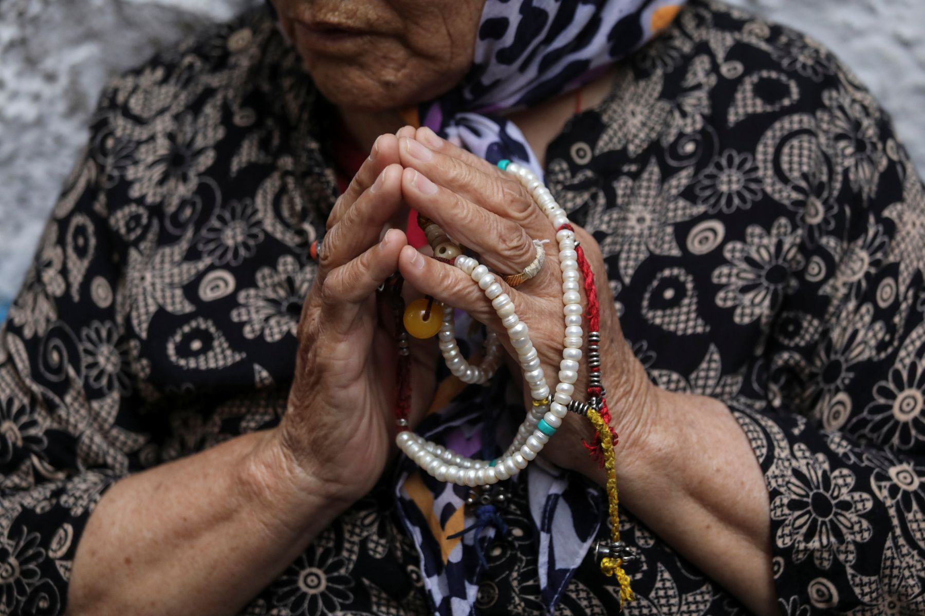 A Tibetan woman attends a special prayer for the health of her spiritual leader the Dalai Lama at a Tibetan refugee colony in New Delhi