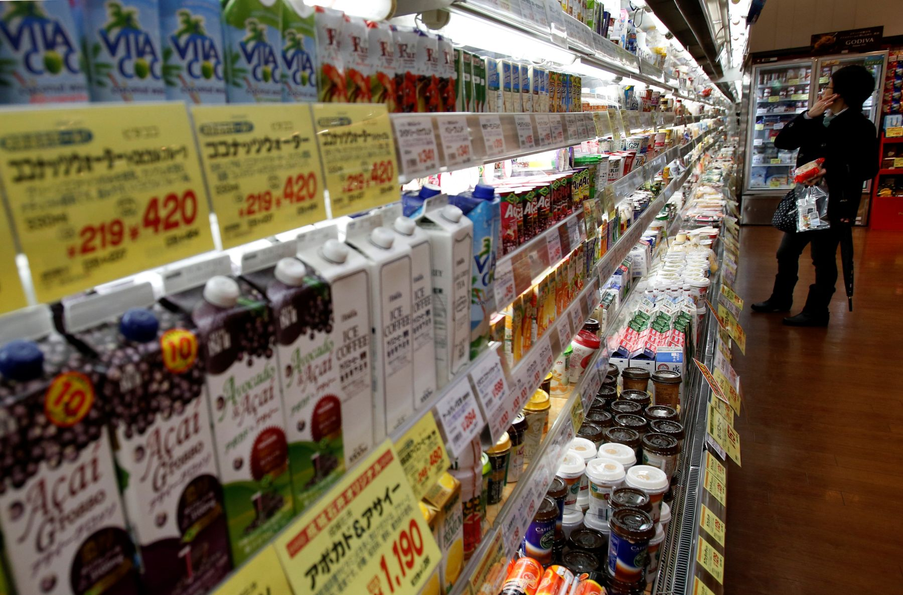 FILE PHOTO: Shopper looks at items at a supermarket in Tokyo