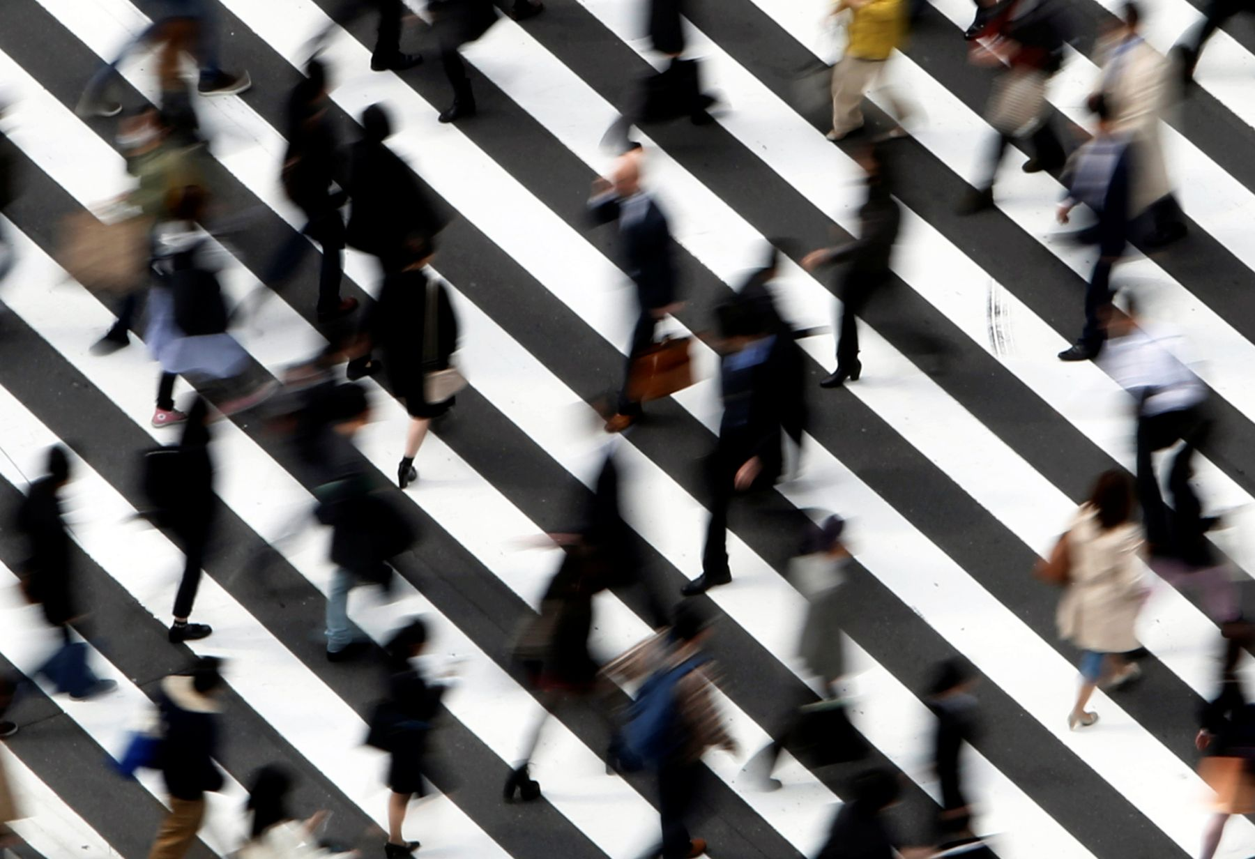 FILE PHOTO: People cross a street in Tokyo