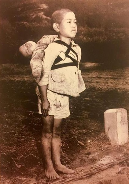 A Boy Standing at a crematory in Nagasaki