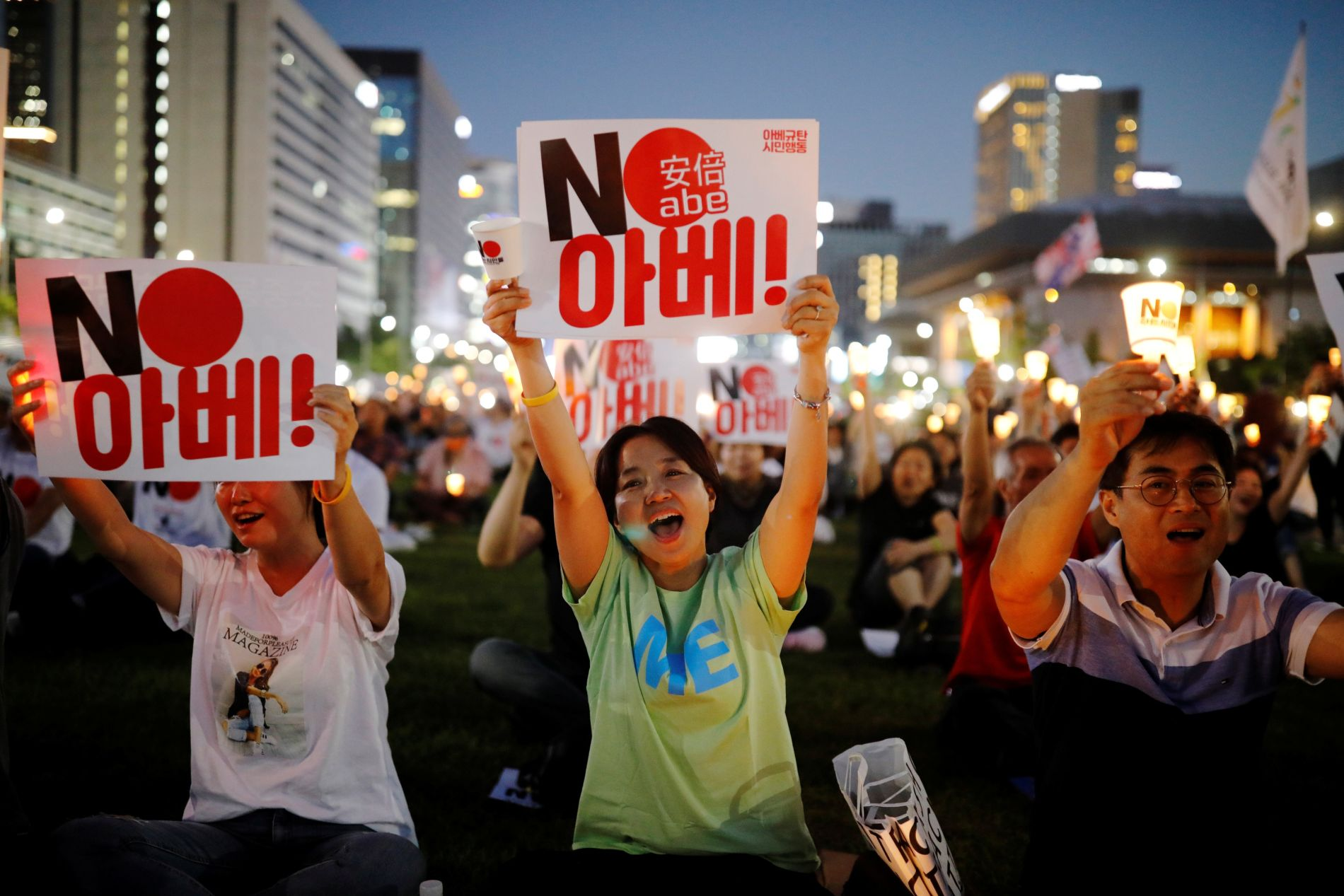 South Korean people chant slogans during an anti-Japan rally in Seoul