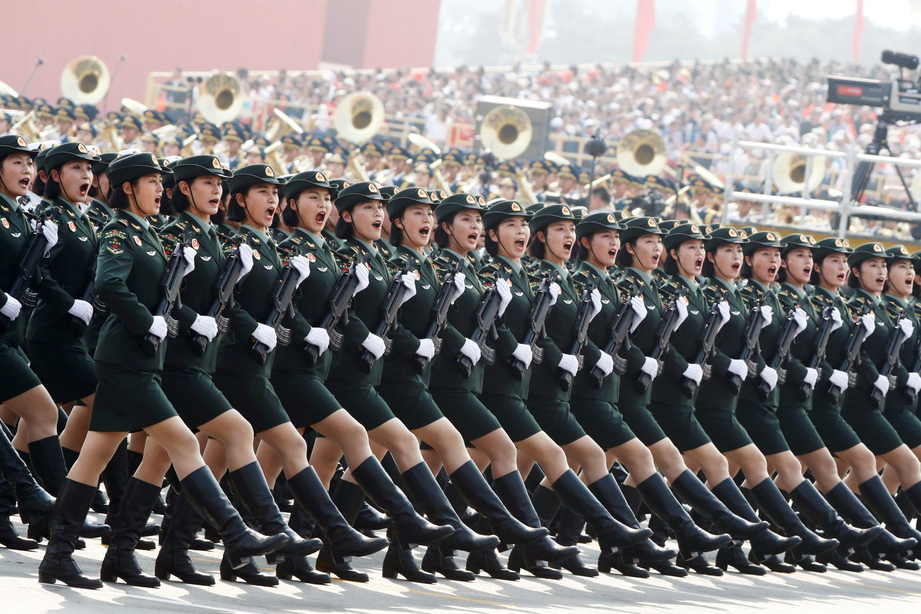 Soldiers of People's Liberation Army (PLA) march in formation during the military parade marking the 70th founding anniversary of People's Republic of China