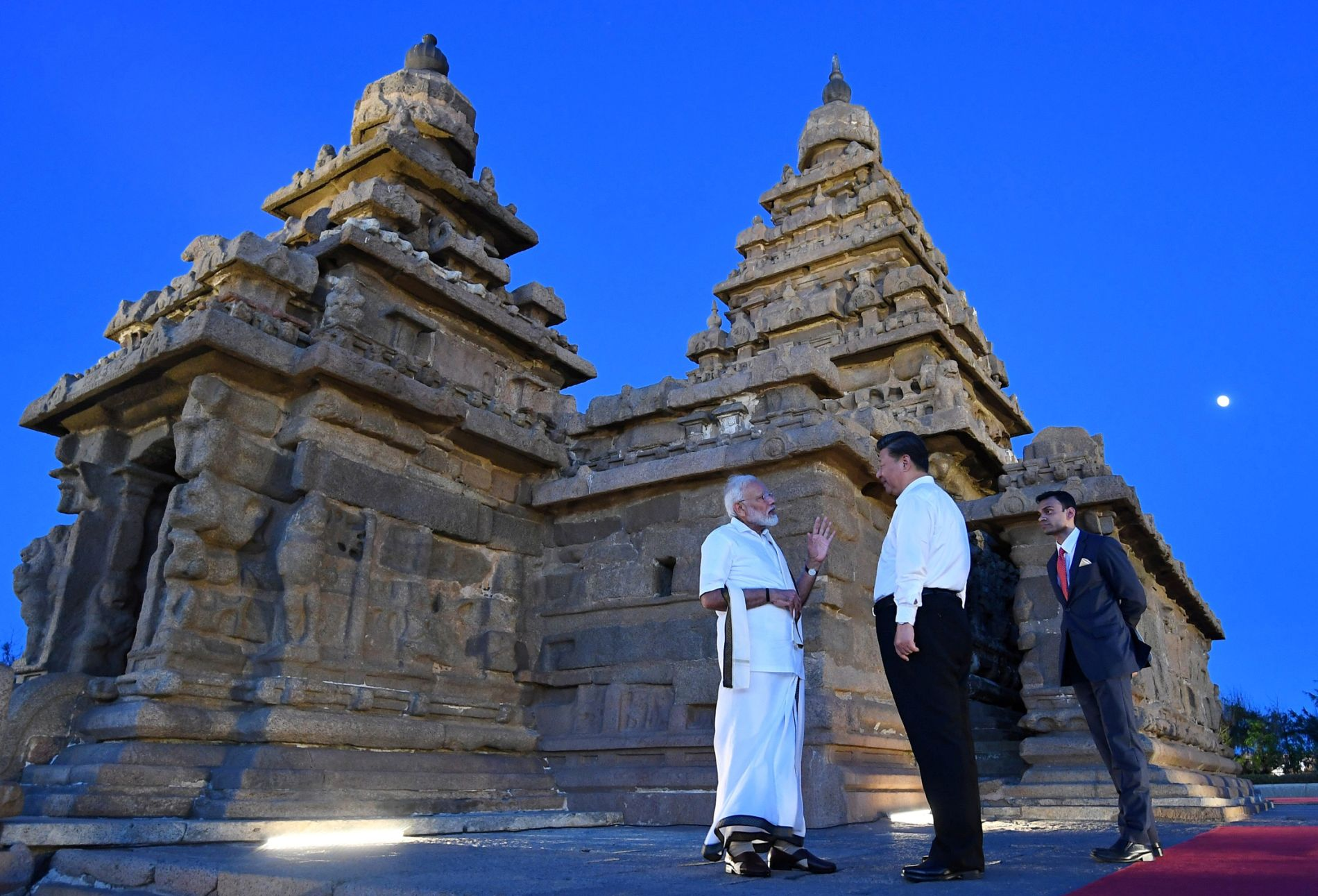 China's President Xi Jinping and India's Prime Minister Narendra Modi talk during their visit to the Shore temple in Mamallapuram