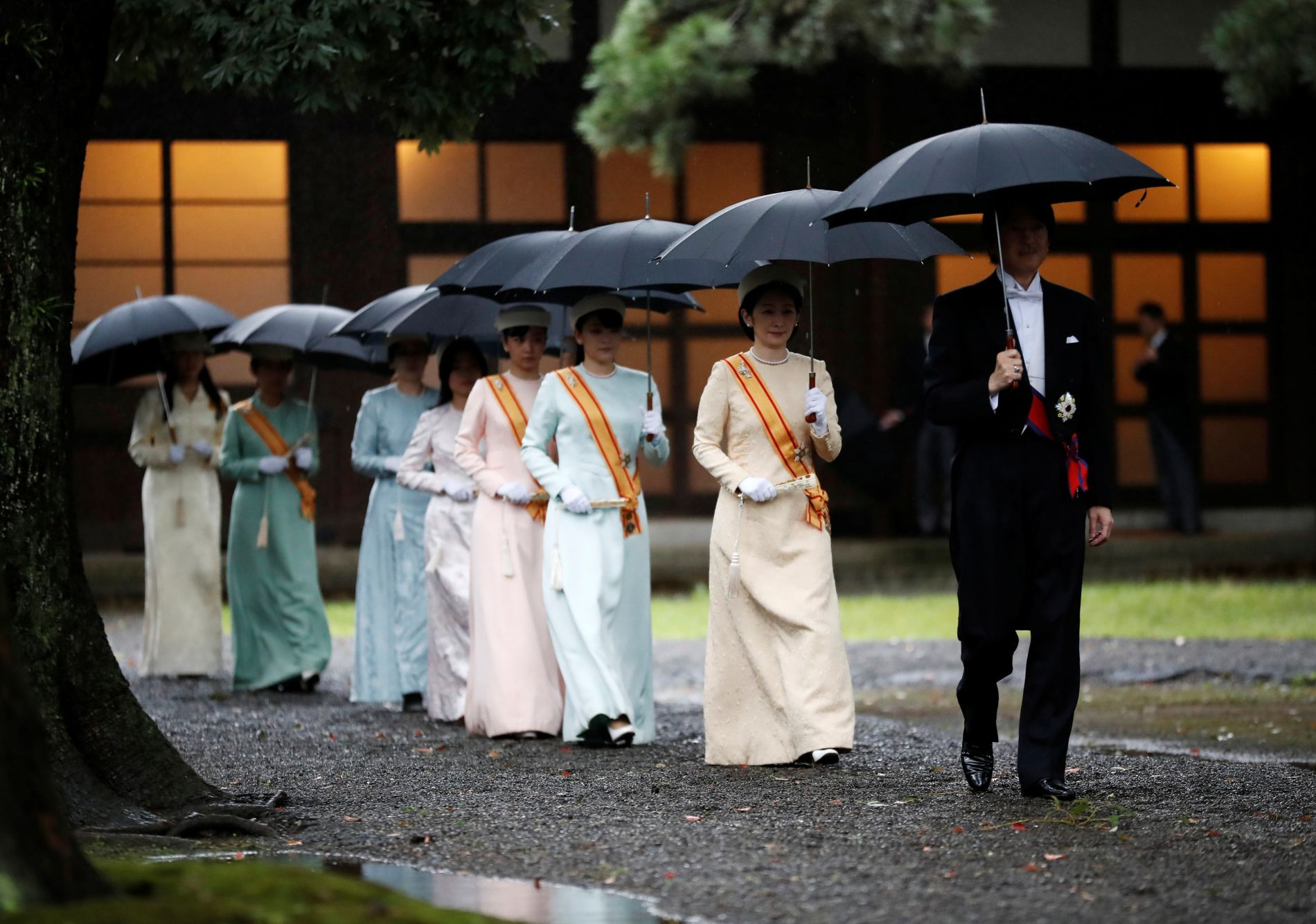 Japan's Prince Akishino and Princess Kiko arrive at the ceremony site where Emperor Naruhito will report the conduct of the enthronement ceremony at the Imperial Sanctuary inside the Imperial Palace in Tokyo
