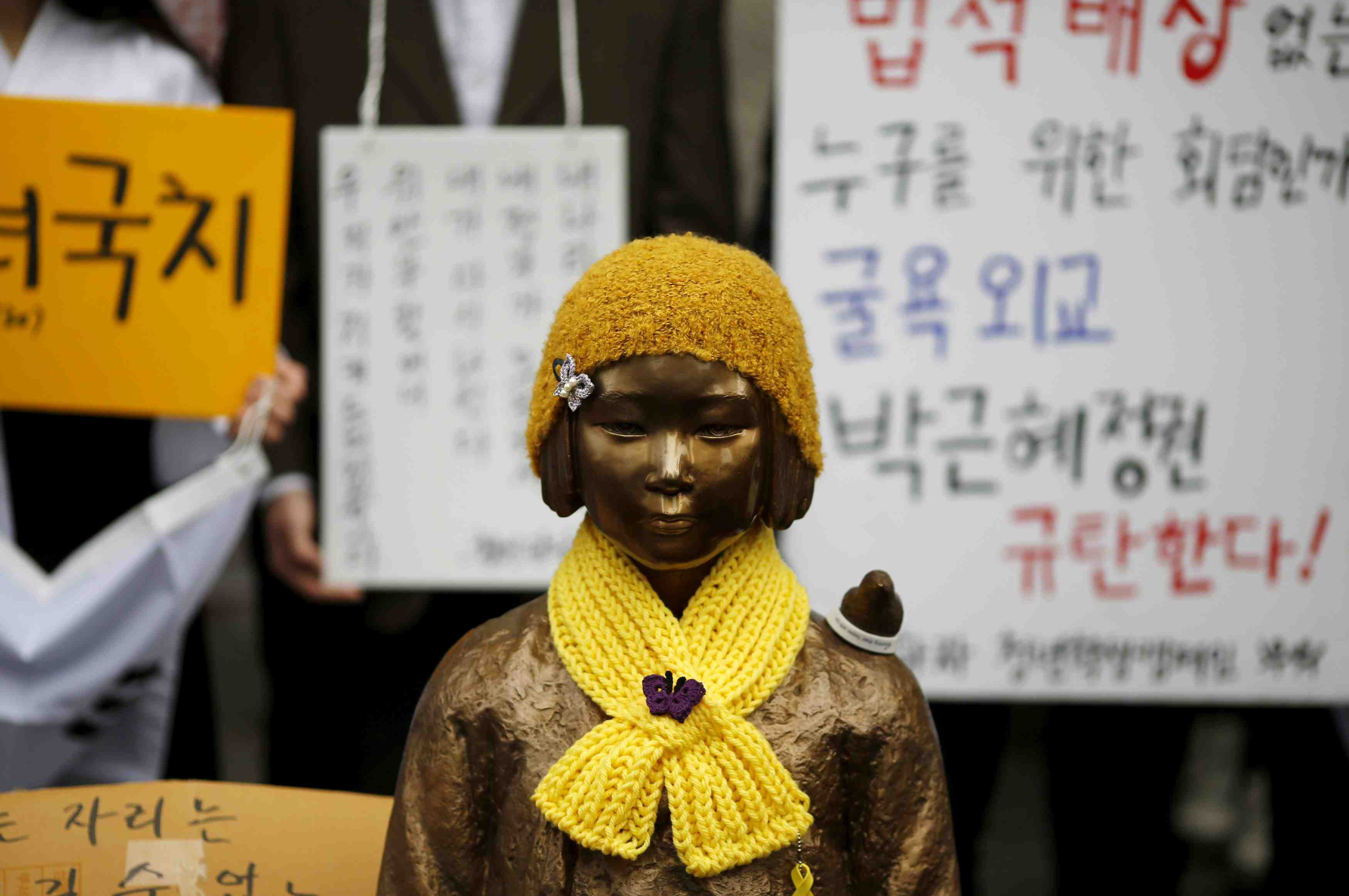 "FILE PHOTO: A statue symbolizing ""comfort women"" is seen during a weekly anti-Japan rally in front of Japanese embassy in Seoul"