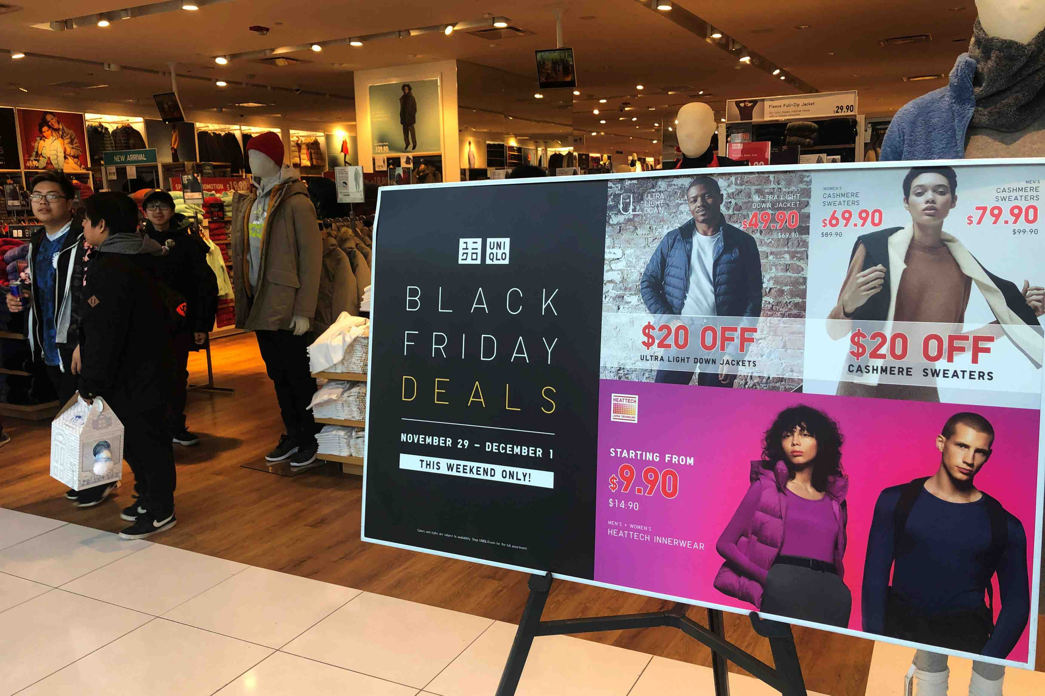 People shop at the Uniqlo store during the Black Friday sales event at Roosevelt Field Mall in Garden City, New York