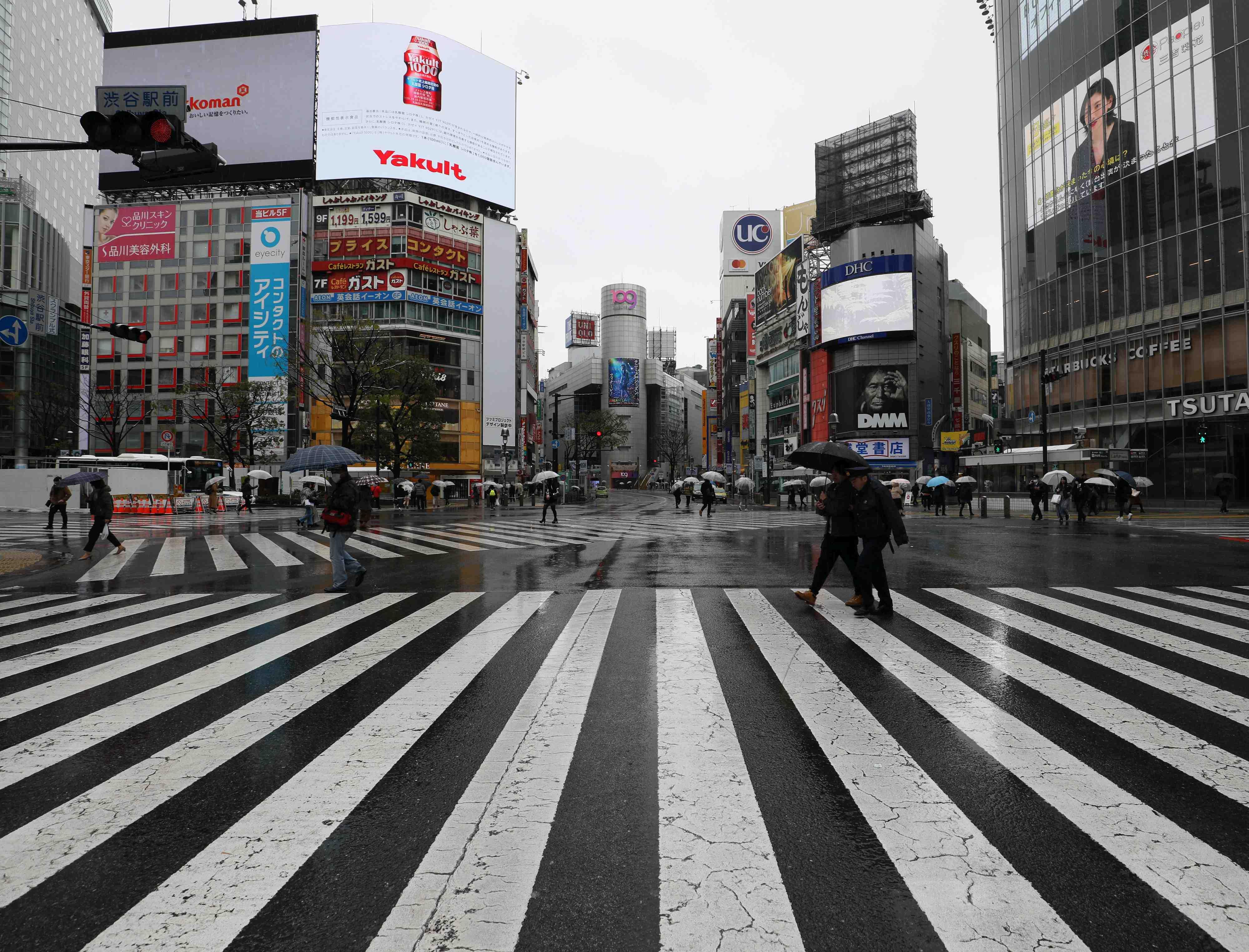 Coronavirus Crisis Spring Snow and Tokyo Olympics Sakura Cherry Blossoms