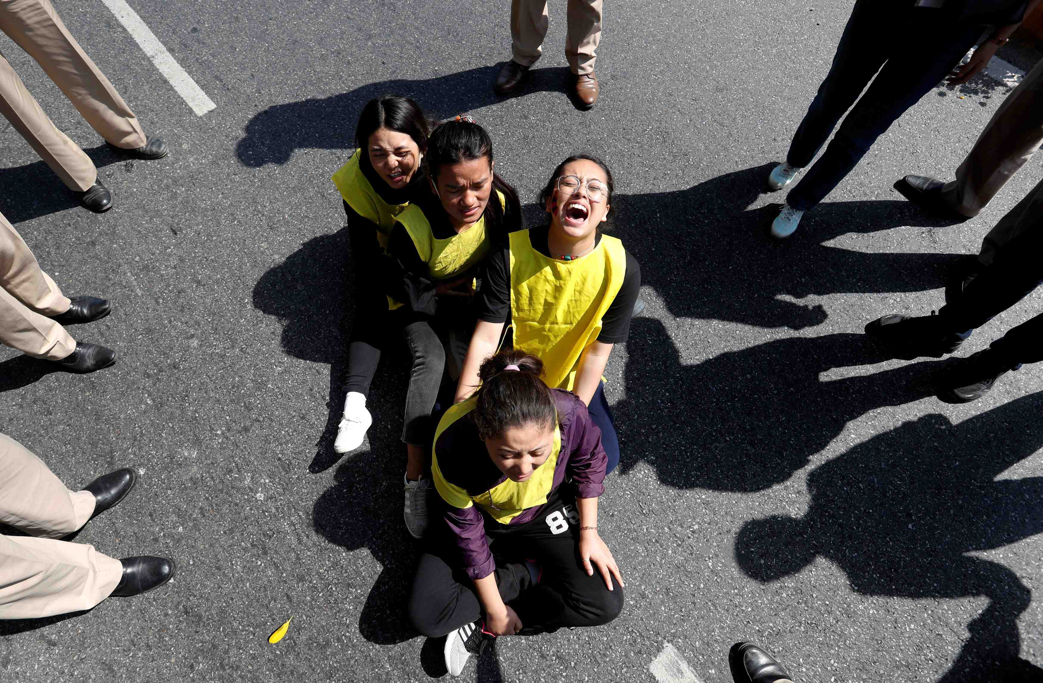 Tibetans shout slogans during a protest in New Delhi