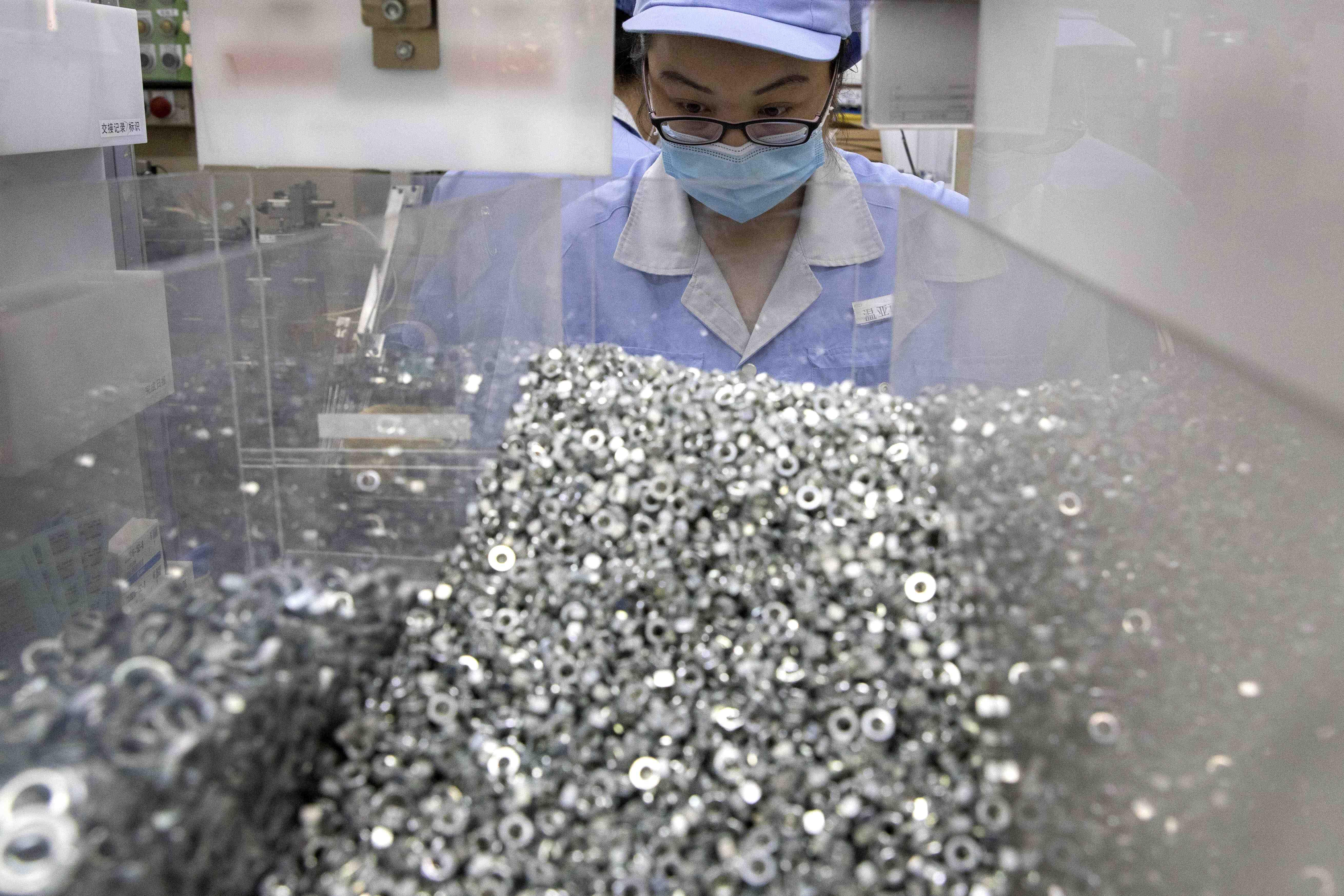 Virus Outbreak China Factory Dilemma