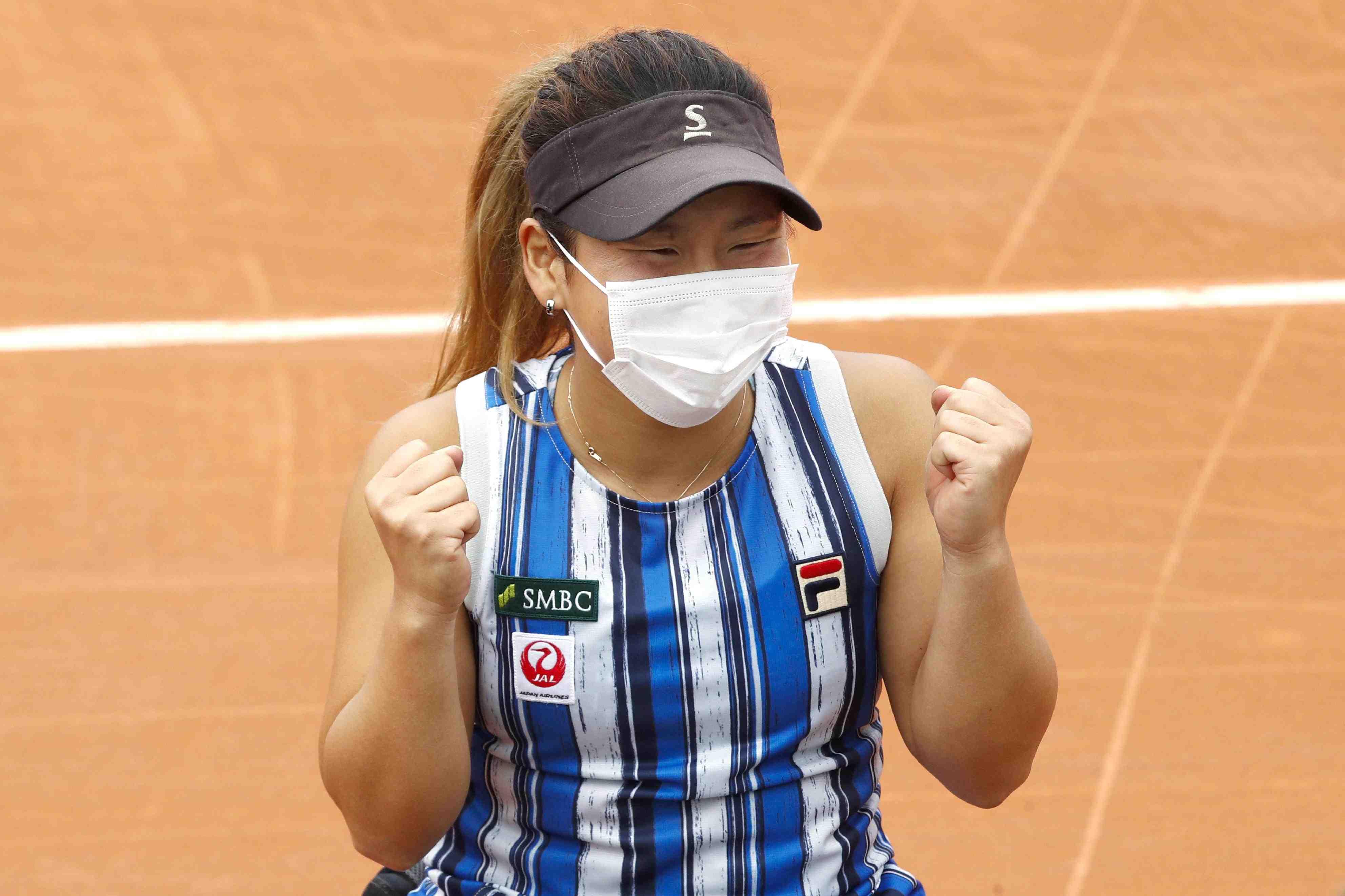 Japan's Yui Kamiji after winning the women's wheelchair final match of the French Open tennis 014