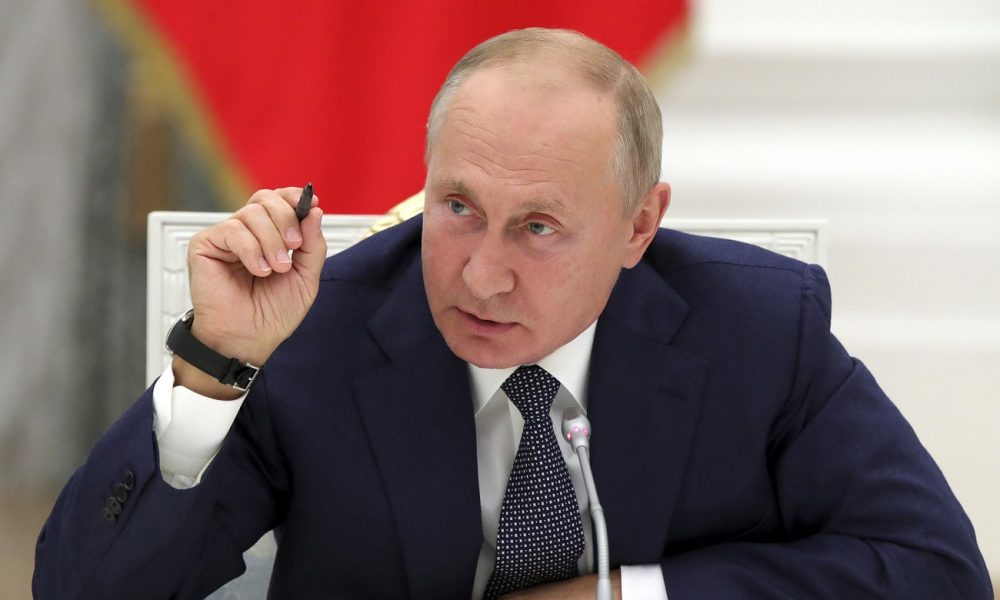 Russian President Vladimir Putin gestures while speaking during a meeting with employees of the nuclear industry on their professional holiday, Nuclear Industry Worker's Day, at the Kremlin in Moscow, Russia, Wednesday, Sept. 23, 2020. (Mikhail Metzel, Sputnik, Kremlin Pool Photo via AP)