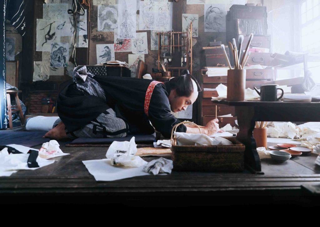 "In this photo provided by 2020 HOKUSAI MOVIE, actor Yuya Yagira performs in a scene from ""Hokusai"". The new film portraying the life of Edo-era painter and printer Hokusai features the artistry of two modern-day Japanese actors. Yagira, who won Cannes Best Actor for his role in Hirokazu Koreeda's ""Nobody Knows,"" plays the younger Hokusai. Internationally acclaimed dancer Min Tanaka portrays the older Hokusai. ""Hokusai"" is the closing film of the Tokyo International Film Festival, ending Monday, Nov. 9. (2020 HOKUSAI MOVIE via AP)"