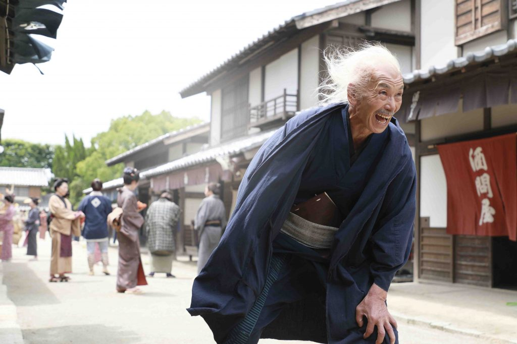 "In this photo provided by 2020 HOKUSAI MOVIE, actor Min Tanaka performs in a scene from ""Hokusai"". The new film portraying the life of Edo-era painter and printer Hokusai features the artistry of two modern-day Japanese actors. Yuya Yagira, who won Cannes Best Actor for his role in Hirokazu Koreeda's ""Nobody Knows,"" plays the younger Hokusai. Internationally acclaimed dancer Tanaka portrays the older Hokusai. ""Hokusai"" is the closing film of the Tokyo International Film Festival, ending Monday, Nov. 9. (2020 HOKUSAI MOVIE via AP)"